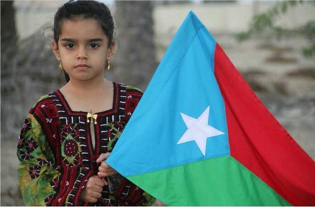 A child waiving the flag of Azad Balochistan