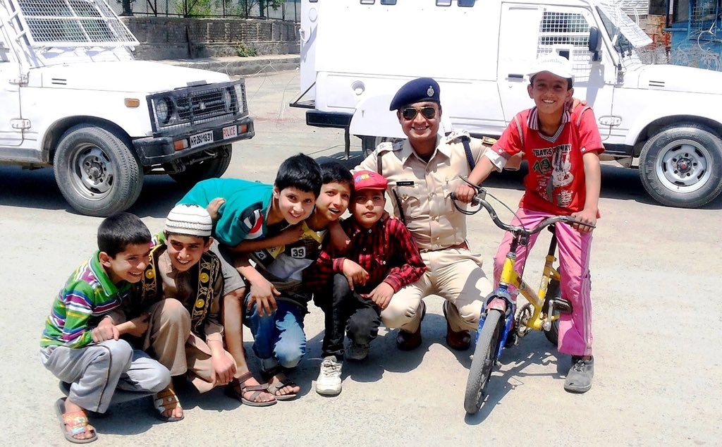 Children chilling around with Police Officer in Kashmir