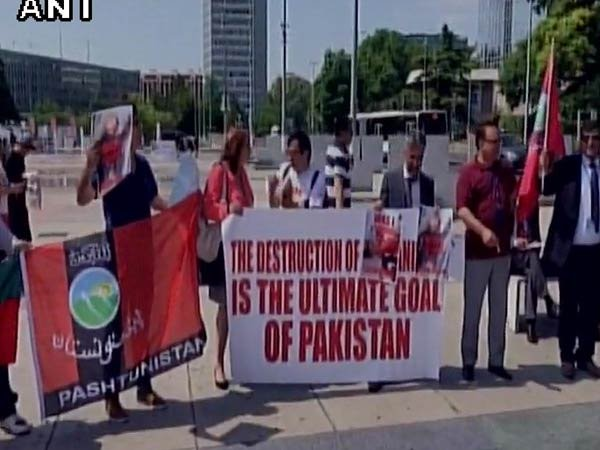 """Demonstrators outside UN Human Rights Conference at Geneva holding Banners of """"Pashtunistan"""" and protesting against Pakistan Army Atrocities and Genocide."""