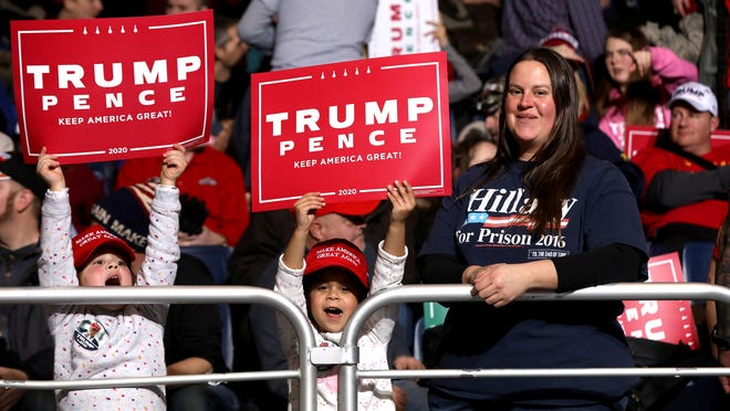 """US President Donald Trump Impeachment:  Trump was at a """"Merry Christmas"""" campaign rally in Battle Creek, Michigan."""