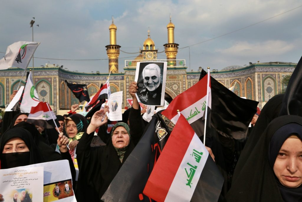 ran threatens Tel Aviv, US bases in Middle East after killing of Soleimani: Shiite Muslims demonstrate over the US airstrike that killed Iranian Revolutionary Guard Gen. Qassem Soleimani, in the posters, in Karbala, Iraq, Jan. 4, 2020 (AP Photo/Khalid Mohammed)