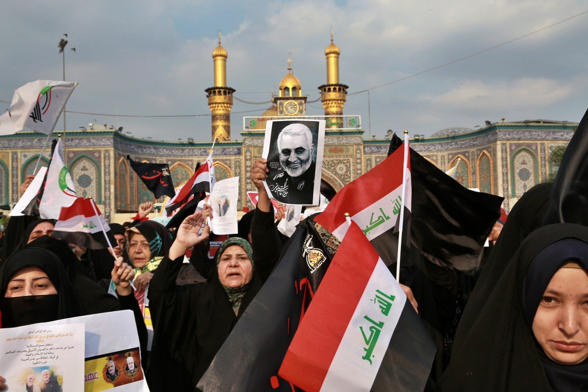Iran threatens Tel Aviv, US bases in Middle East after killing of Soleimani: Shiite Muslims demonstrate over the US airstrike that killed Iranian Revolutionary Guard Gen. Qassem Soleimani, in the posters, in Karbala, Iraq, Jan. 4, 2020 (AP Photo/Khalid Mohammed)