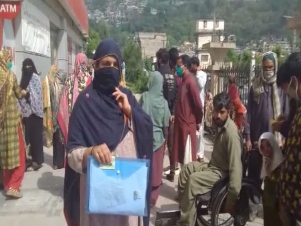Residents of POK standing in long queues outside the banks for aid, however later to be told that they are not eligible despite meeting all criterion.
