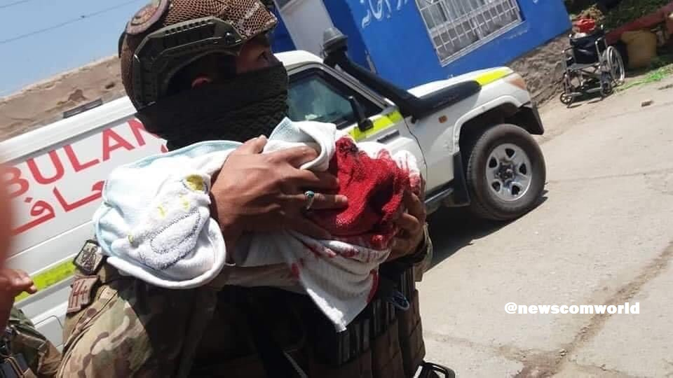President Ghani Orders Offensive against Pakistan Supported Taliban Terrorists: A Security officer rescuing an injured new born baby from the Maternity hospital
