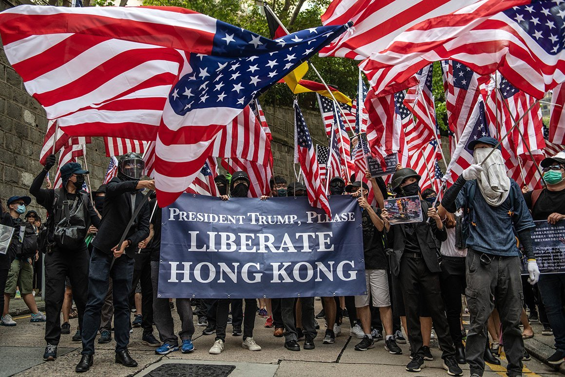 "China in Focus - Hong Kong Protesters wave US Flag and hold banners ""President Trump, Please Liberate Hong Kong"""