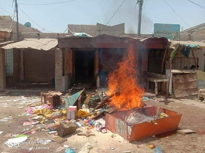 Angry protesters set fire to shops owned by Hindus and burnt tyres on road in Pakistan