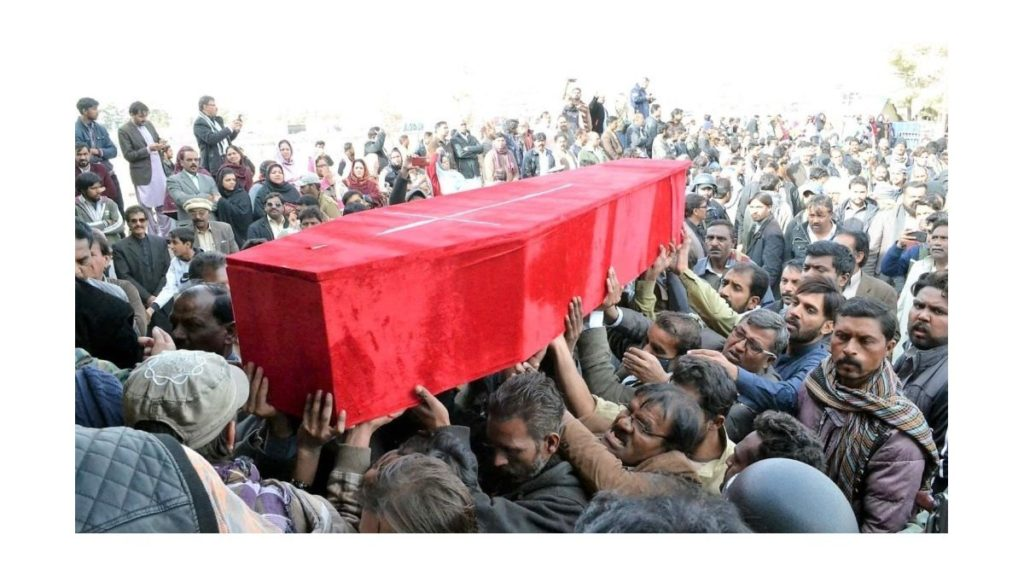 Mourners carrying coffin of one of the dead Christians in church attack in Pakistan