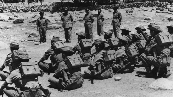 Chinese Aggression at Indian Border: Image of 1962 Indo-China War. Indian Soldiers going to defend Indian borders from the invading Chinese PLA.