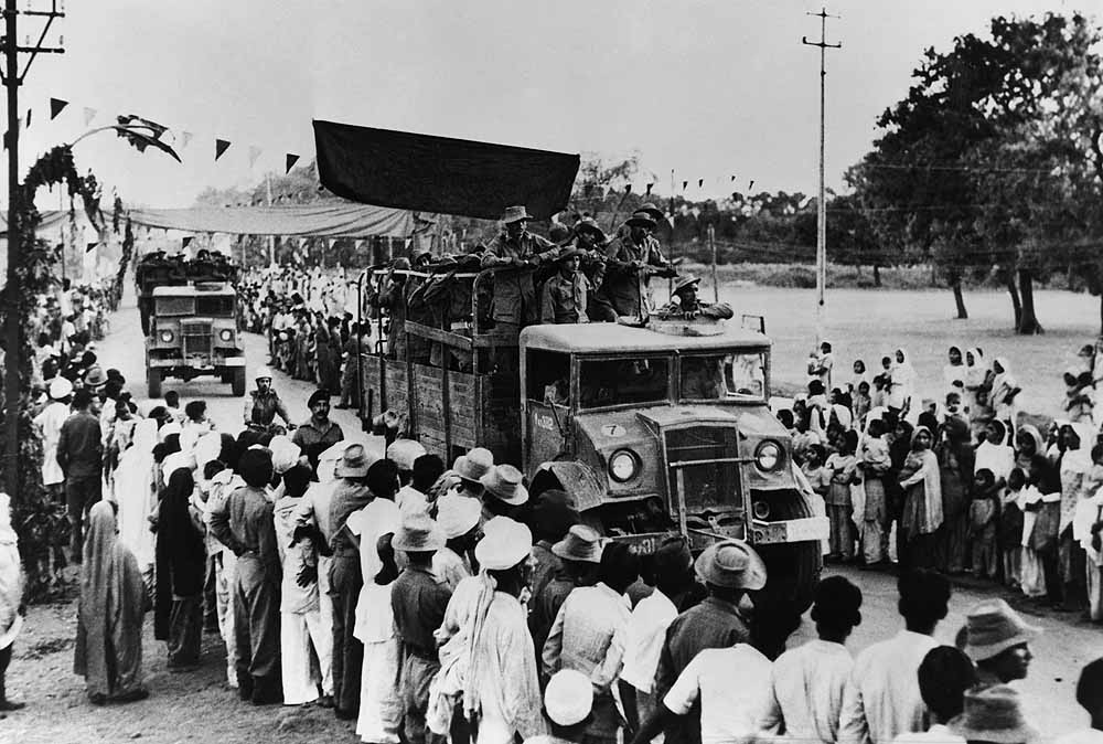Chinese Aggression at Indian Border: Image of 1962 Indo-China War. Crowds waiving to Indian Soldiers going to defend Indian borders from the invading Chinese PLA.