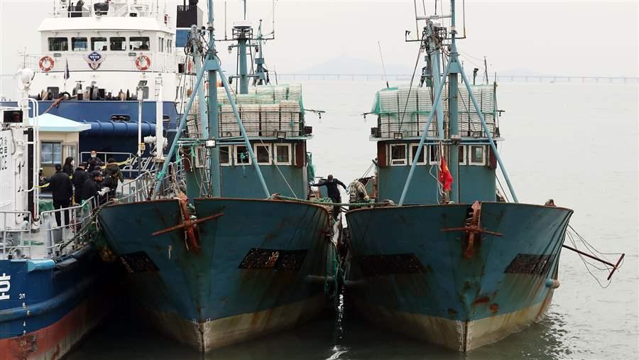 China Stealing Fish Stock Of The World: Flash point of Conflicts: South Korea's coast guard accused two Chinese vessels of fishing illegally in South Korean waters. No IMO numbers are visible on the hull of either ship.