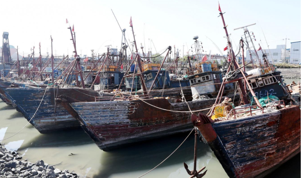 China Stealing Fish Stock Of The World: Flash point of Conflicts - Chinese fishing boats captured by South Korean coast guard are seen at a port in Incheon, South Korea, October 10, 2016. Yoon Tae-hyun/Yonhap via REUTERS