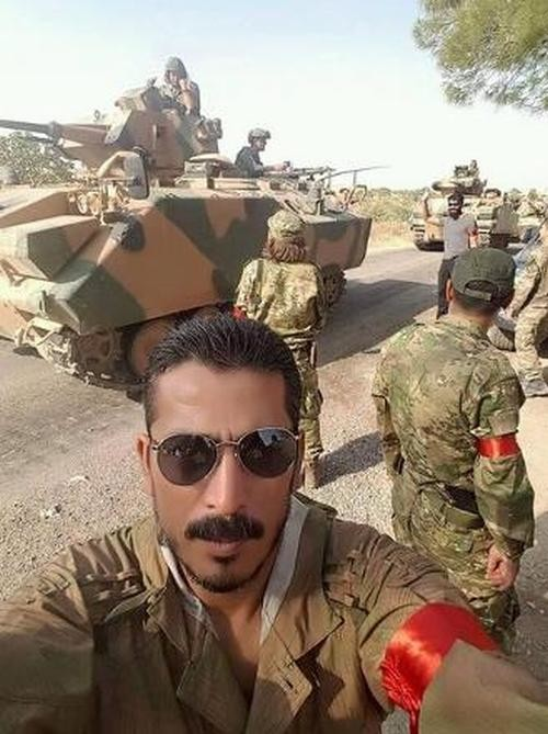 Terrorists from Syria, Pakistan, Libya wearing red bands on their arms