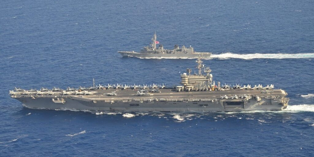 Communist China threatens Democratic Taiwan with Invasion : Will US Protection be sufficient? USS Ronald Reagan (CVN-76) and its strike group in South China Sea