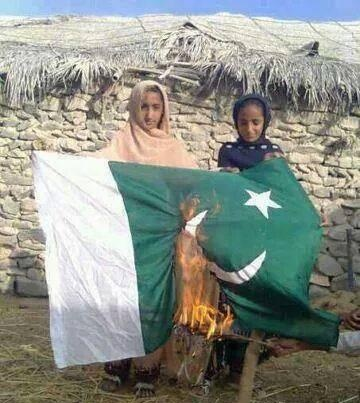 2 young girls burning the Pakistani Flag