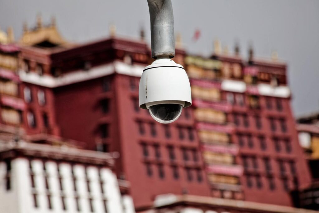 A surveillance camera is seen in Lhasa, China Occupied Tibet, with the Potala Palace in the background
