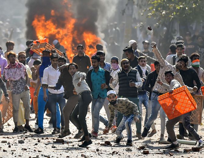 Democracies From US to India Under Attack : Rioters in Delhi attacking police with bricks and stones