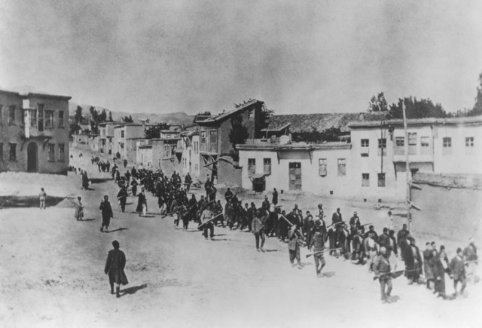 Ottoman military forces march Armenian men from Kharput to an execution site outside the city. Kharput, Ottoman Empire, March 1915-June 1915.   Armenian Genocide   NewsComWorld.com