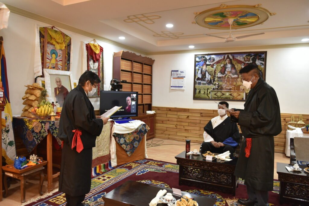 Penpa Tsering (R) Sworn in as the President of the Tibetan Government in-Exile - He takes the oath of office and secrecy before the Chief Justice Commissioner of the Central Tibetan Administration, Mr Sonam Norbu Dagpo, (L) at the swearing-in ceremony at the Tibetan Supreme Justice Commission, Dharamsala, on 27 May 2021. | NewsComWorld.com