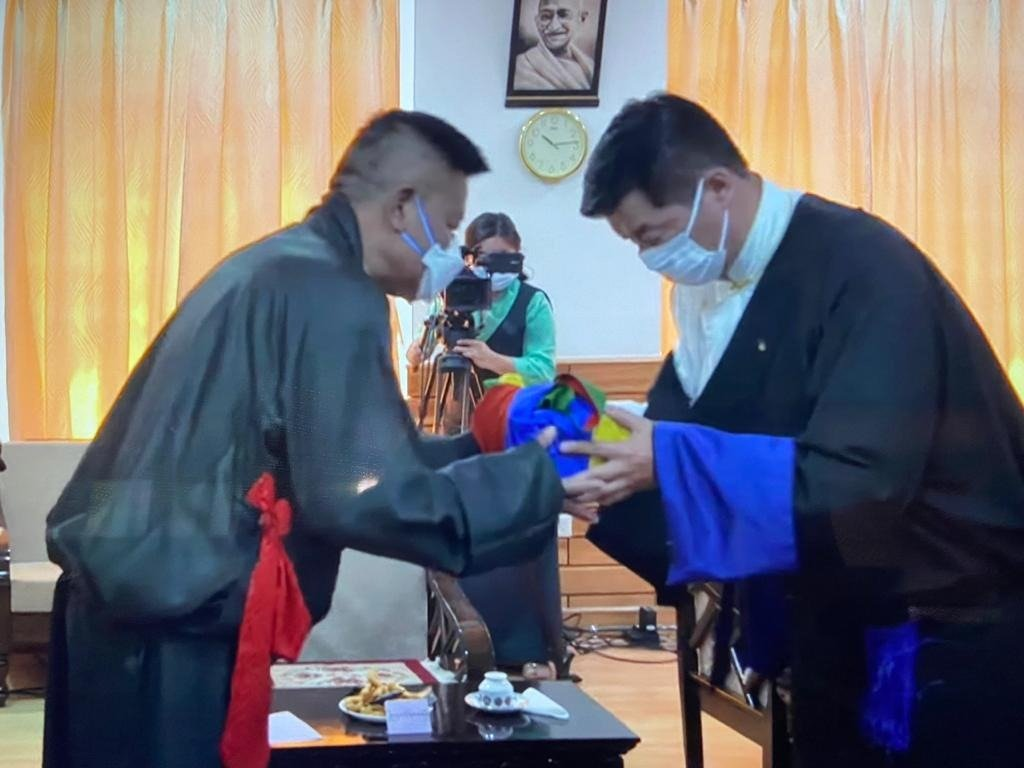 Penpa Tsering Sworn in as the President of the Tibetan Government in-Exile - Outgoing Sikyong Dr Lobsang Sangay handing over the Official Seal of the Kashag to new Sikyong Penpa Tsering, at the swearing-in ceremony, 27 May 2021. | NewsComWorld.com