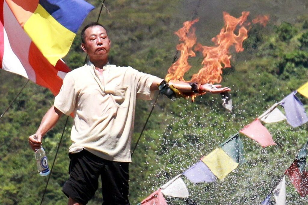 Lau Kin-kwok, chief of the Po Yin Fat Yuen monastery, set his left arm on fire. China Recruiting Tibetans in PLA for deployment at LAC with India, May Backfire China
